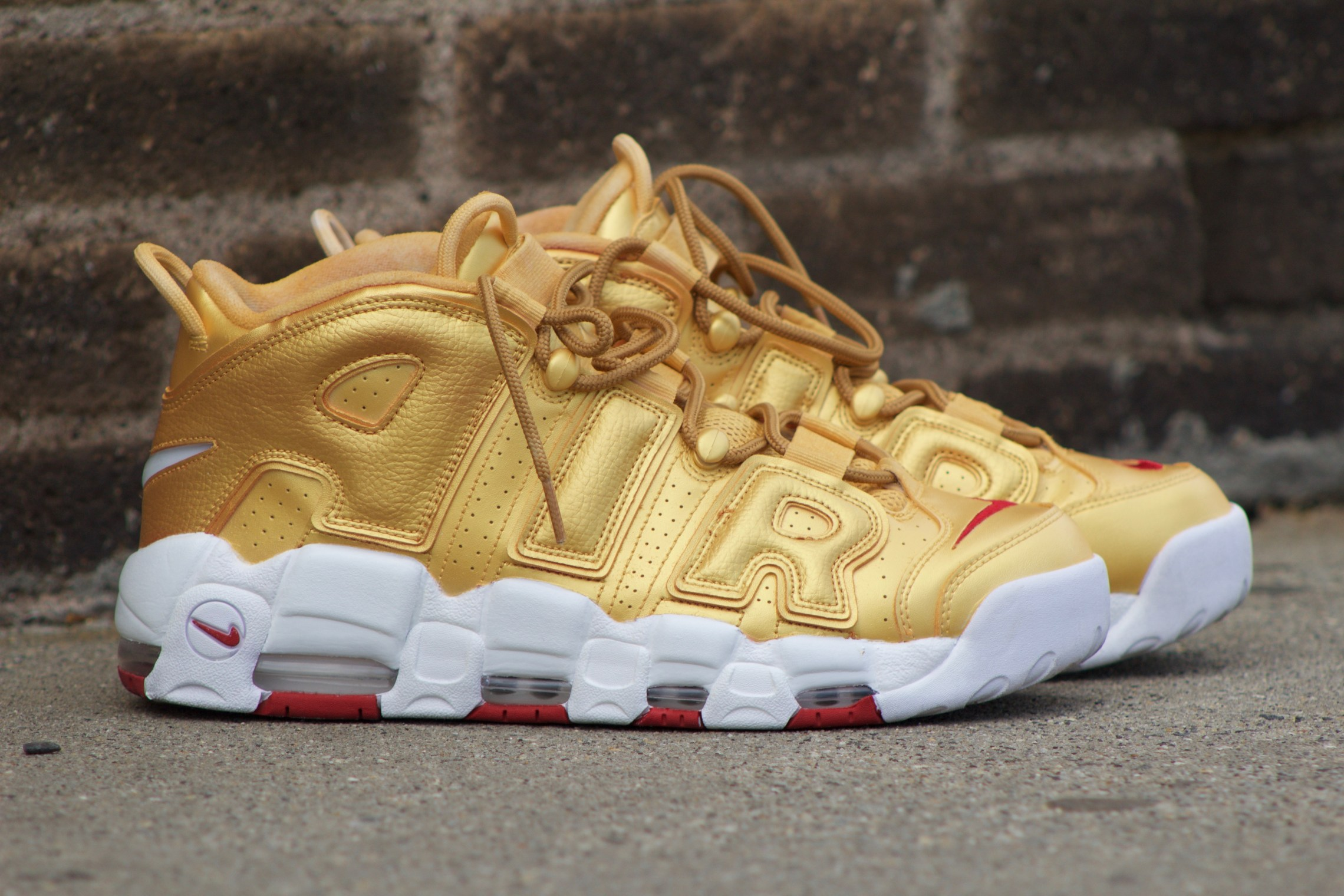 215654f6eaea official store nike air more uptempo womens gold yellow 15dda f0a12